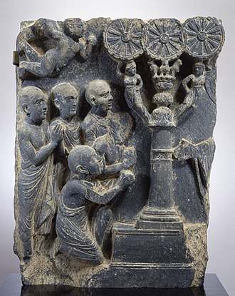 Four Noble Truths - A relief depicting the first discourse of the Buddha, from the 2nd century (Kushan). The Walters Art Museum. The Buddha's hand can be seen at right.