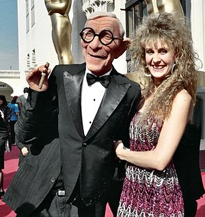 George Burns - Woman with man wearing George Burns body puppet