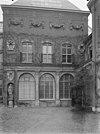 gevel met bouwfragmenten - amsterdam - 20022041 - rce