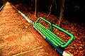 Green outdoor metal bench.jpg