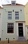 foto van Pand met verdieping en schilddak
