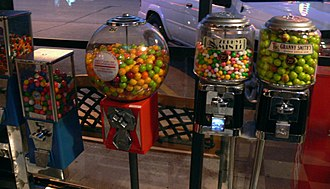 Bulk vending - An assortment of modern gumball machines on location in a Dallas storefront.