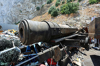Levant Battery - The gun and mount from the Levant Battery in Gibraltar is at Metalrok Limited in Gibraltar. The gun still has its Mark V mount and has been there for about forty years resting on its original trailer.
