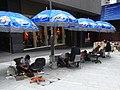 HK Central Theatre Lane outside stalls street Shoeshiners beach umbrella Sept-2012.JPG
