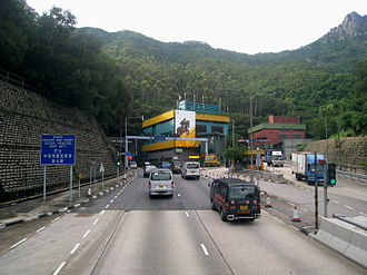 """Lion Rock Tunnel - New Kowloon side. The """"new"""" tunnel is on the left, the """"old"""" tunnel is on the right. Lion Rock is visible in the top right corner."""