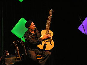 Harry Manx with an instrument called a Moheen Veena.