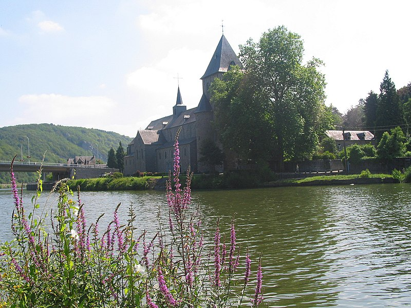 Hastière-par-Delà   (Belgium), the St. Peter Abbey church (1033-1035) and the Meuse River.