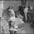Heart Mountain Relocation Center, Heart Mountain, Wyoming. Shoemakers at work in the shoe repair sh . . . - NARA - 539209.tif