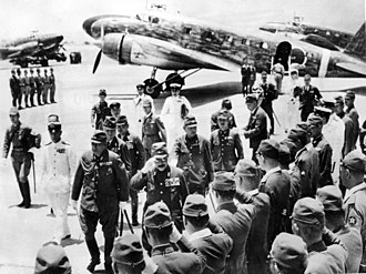 Hideki Tojo - Japanese Prime Minister Hideki Tojo landed in Nichols Field, an airfield south of Manila, for state visit to the Philippines.