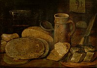 Hieronymus Francken (II) - Still life with pottery, herring and pancakes, a print of an owl on the wall.jpg
