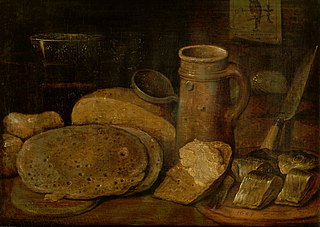 Still life with pottery, herring and pancakes, a print of an owl on the wall
