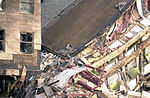 High angle view showing damage to the Western ring wall of the Pentagon Building after the September 11, 2001 attacks 010911-N-PU293-014.jpg