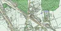 A coloured historic map showing the houses roads and woods around Highgate station, which is located in a cutting
