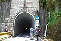 Hikers entering the east portal of Hehuanshan Tunnel.jpg