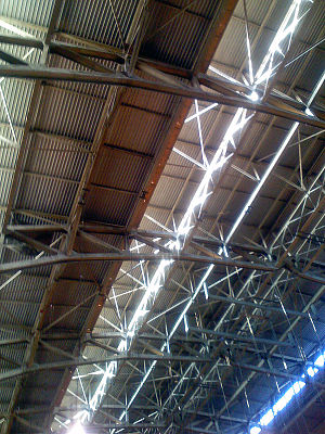 Girder - The ceiling of Hinkle Fieldhouse in Indianapolis, Indiana, was constructed of large trusses built of riveted girders.