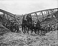 Horse team of the Royal Field Artillery pulling an 18 pounder field gun up the slope of a cutting through the bank of the Canal du Nord near Moeuvres, 27 September 1918. Q9347.jpg