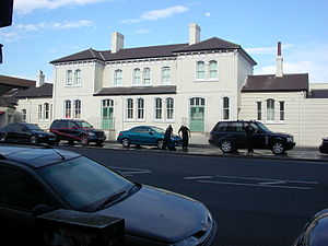 Hove railway station - The original station building at Hove, now used as a hand car wash.