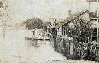 1896 Cedar Keys hurricane - Residents of Cedar Key rowing a boat through residual floodwaters after the hurricane