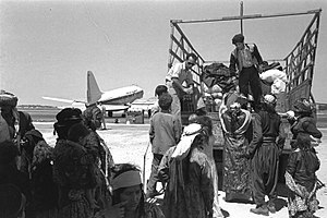 Operation Ezra and Nehemiah - Immigrants from Iraq leaving Lod airport on their way to ma'abara, 1951