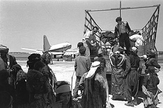 El Al - Kurdish Jewish Immigrants from Iraq leaving Lod Airport (1951)