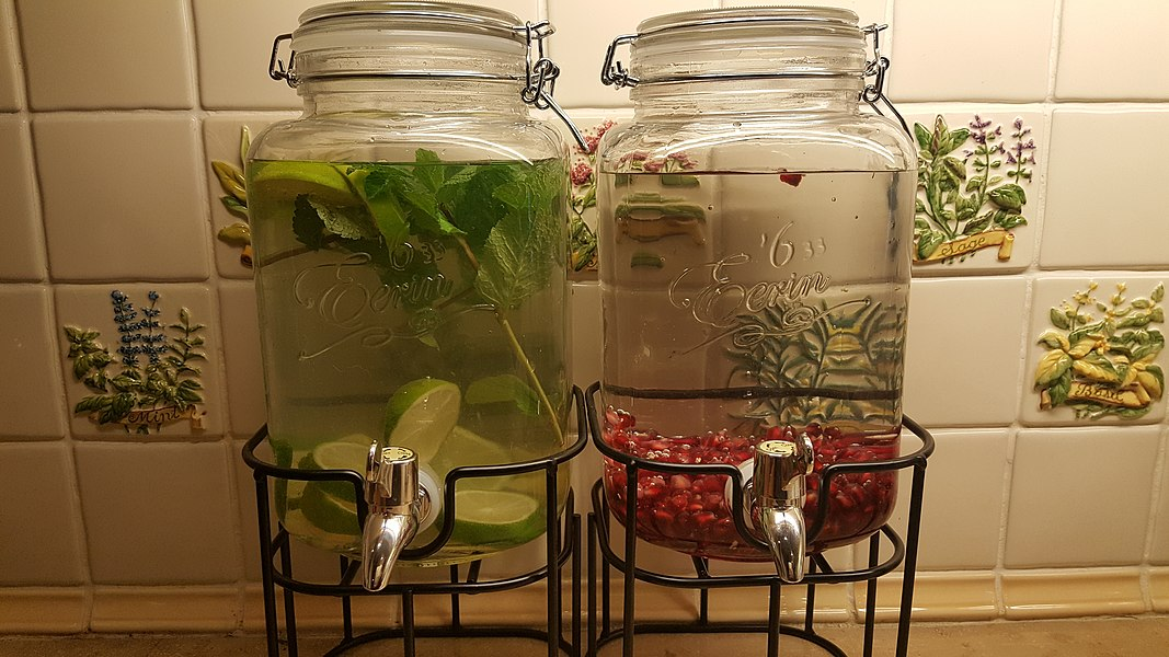Infused Water Jars Left side: Lime, ginger and mint infused water  Right side: Pomegranate infused water