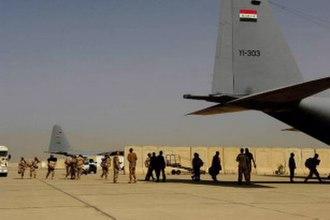 Battle of Basra (2008) - Members of the Iraqi Army board an Iraqi C-130 Hercules for a flight to Basra, Iraq at New Al Muthana Air Base in Baghdad on 30 Mar.
