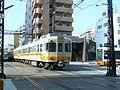 Iyotetsu tram and train meet.jpg