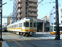 Iyotetsu tram and train meet.jpg