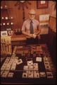 JEWELRY STORE OWNER, MIKE CROSS, MAKES TIE TACKS, EARRINGS AND PAPER WEIGHTS FROM POLISHED CHUNKS OF OIL SHALE - NARA - 552637.tif