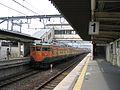 JNR 113 Shonan and JRW liveries leaving Umahori Station 2006-04-04.jpg