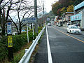 Japanese-route-20-80km-point-and-Shiotsu-station-entrance.jpg