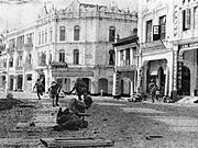 A scene during World War II on the streets of Kuala Lumpur. The scene depicts Japanese troops clearing up the streets.