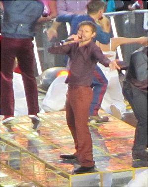 Jason Orange - Orange on stage with Take That in Dublin, June 2011