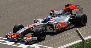 Jenson Button driving for McLaren during a pra...