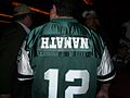 Jets fan with Namath nameplate upside down at NFL Draft 2010 (4544486795).jpg
