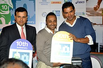 John Abraham smiles with other two men at the camera