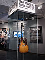 "John Lennon's missing 1962 Gibson J-160E guitar in the exhibit (clip1) - ""Ladies and Gentlemen... the Beatles!"" exhibit at LBJ Presidential Library, Austin, TX, 2015-06-10 10.42.09.jpg"