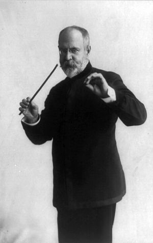 Baton (conducting) - John Philip Sousa conducting with a baton (1911).