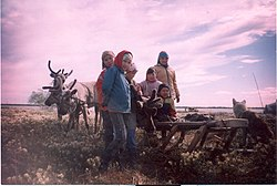 Khanty children in front of a reindeer sledge.jpg
