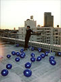 Kido standing with baloons.jpg