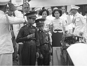 Ananda Mahidol - Thirteen year old King Ananda of Siam (left), and his brother Prince Bhumibol Adulyadej (right), inspect a model train presented to him at Saranrom Park in Bangkok in 1938.