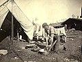 Klondiker using washboard outside of tent, Yukon Territory, ca 1898 (MEED 75).jpg