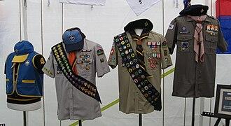 Korea Scout Association - Uniforms (left to right): Beaver Scout, Cub Scout, Scout/Venture Scout, Rover Scout