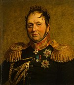 Painting shows a chubby, balding man with round face. He wears a very dark military uniform with gold epaulettes and a red and gold collar.