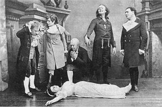 The Tales of Hoffmann - The death of Antonia (act 2) in the original 1881 production. In front: Adèle Isaac; in back (left to right): Hippolyte Belhomme, Marguerite Ugalde, Pierre Grivot, Émile-Alexandre Taskin, Jean-Alexandre Talazac.