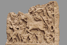 stone relief sculpture of horse and men