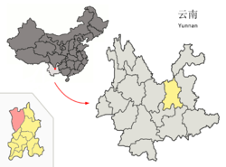 Location o Luquan Coonty (pink) an Kunming prefectur (yellae) athin Yunnan province o Cheenae