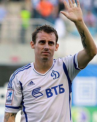 Luke Wilkshire - Wilkshire waving to the Dynamo Moscow supporters following the match.