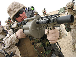 Milkor MGL - A U.S. Marine looks through the M2A1 reflex sight on a newly-issued M32 MGL (MGL-140) in September 2006.