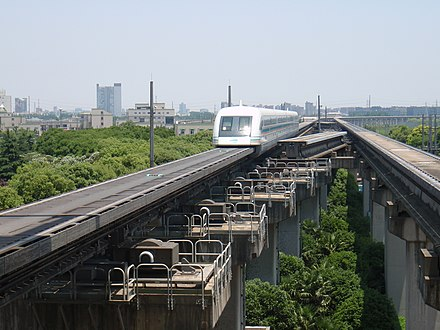 The Maglev with a top speed of 431 km/h (268 mph) exiting the Shanghai Pudong International Airport Maglev Train - panoramio.jpg
